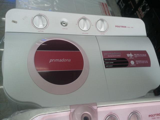 memperbaiki mesin cuci pembuangan air